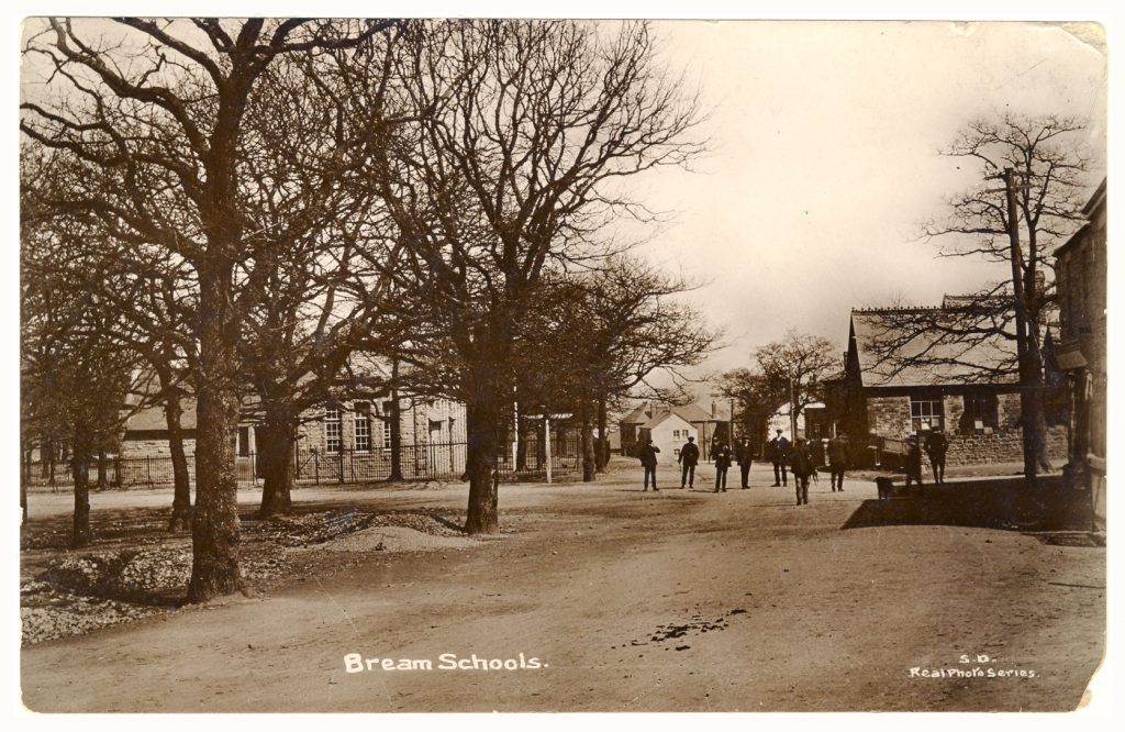 A photo of Bream Schools showing men in the street and the Hard Up Tree