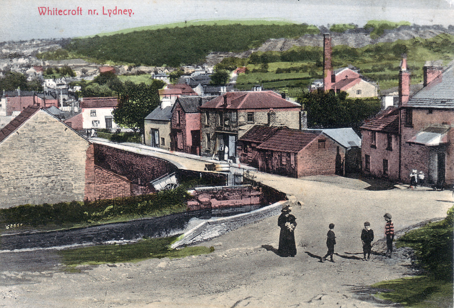 An old postcard of Whitecroft with the Mill, the Patent Feul Works and the Millpond.