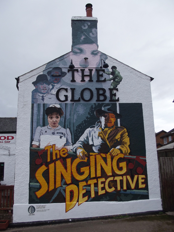A photo of The Singing Detective mural by Tom Phelps