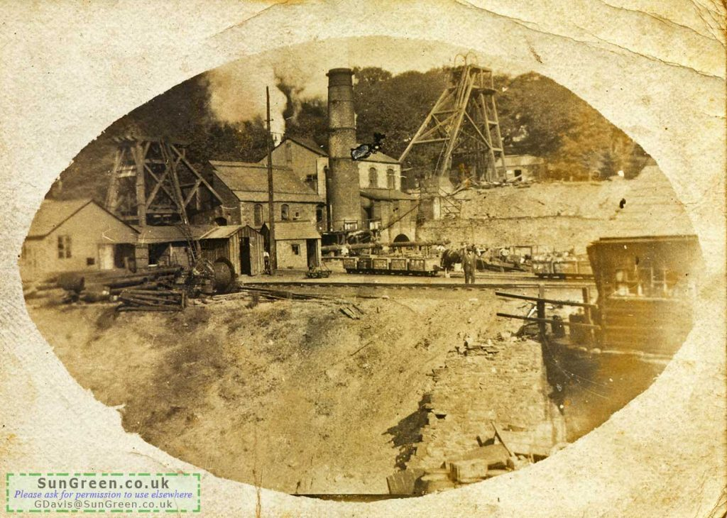A photo of Flourmill Colliery with drams and a horse